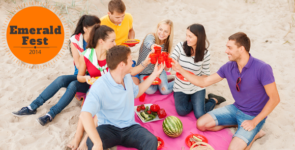 Friends celebrating on a beach blanket
